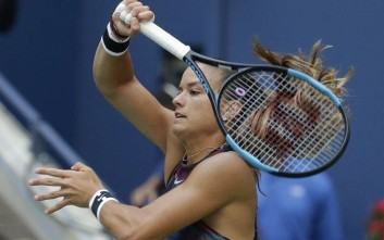 Maria Sakkari, of Greece, returns a shot from Venus Williams, of the United States, during the third round of the U.S. Open tennis tournament, Friday, Sept. 1, 2017, in New York. (AP Photo/Seth Wenig)