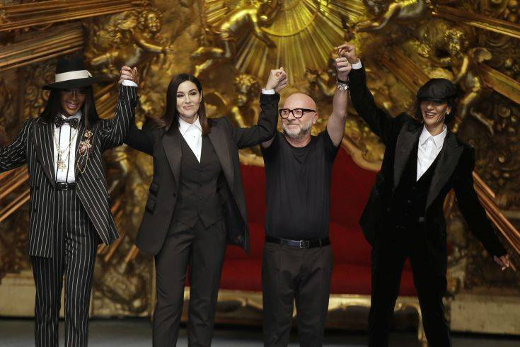 Model Naomi Campbell, from left, actress Monica Bellucci and designer Domenico Dolce accept applause at the end of Dolce & Gabbana's men's 2019 Spring-Summer collection, unveiled during the Fashion Week in Milan, Italy, Saturday, June 16, 2018. (AP Photo/Luca Bruno)