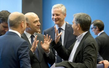 Greek Finance Minister Euclid Tsakalotos, right, speaks with from left, German Finance Minister Olaf Scholz, European Commissioner for Economic and Financial Affairs Pierre Moscovici and French Finance Minister Bruno Le Maire during a meeting of eurogroup finance ministers at EU headquarters in Luxembourg on Thursday, June 21, 2018. Eurozone nations are working on the final elements of a plan to get Greece successfully out of its eight-year bailout program and keep its massive debt burden manageable. (AP Photo/Virginia Mayo)