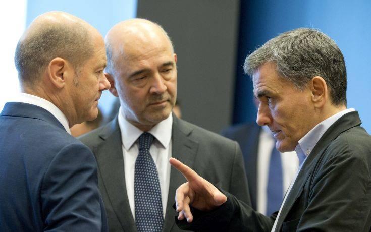 Bloomberg: Συμφωνία ορόσημο για το ελληνικό χρέος
