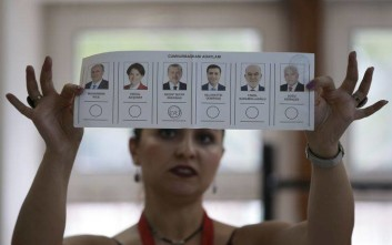 A vote for Turkey's President and ruling Justice and Development Party, or AKP, leader Recep Tayyip Erdogan is counted at a polling station in Istanbul, Sunday, June 24, 2018. The polls have closed in Sunday's Turkish landmark presidential and parliamentary elections where President Recep Tayyip Erdogan is seeking re-election to a presidency with vastly expanded powers. (AP Photo/Emrah Gurel)