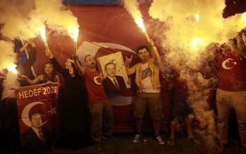 Supporters of Turkey's President and ruling Justice and Development Party, or AKP, leader Recep Tayyip Erdogan celebrate outside the party headquarters in Istanbul, Sunday, June 24, 2018. Unofficial results from Turkey's presidential election show incumbent Recep Tayyip Erdogan with a commanding lead. (AP Photo/Emrah Gurel)