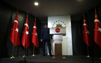 Turkey's President Recep Tayyip Erdogan leaves after delivering a statement on national television from his official residence in Istanbul, Sunday, June 24, 2018. Erdogan has claimed victory in critical elections based on unofficial results, securing an executive presidency with sweeping powers. (AP Photo/Lefteris Pitarakis)