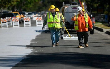 Jordan Avenue, north of Hart Street is getting a new surface coating similar to slurry seal. However, instead of traditional black asphalt, this coat is a concrete color designed to reflect heat. This is the first such installation on a public street in the State of California. Canoga Park., CA. 5/20/2017 Photo by John McCoy/Los Angeles Daily News (SCNG)