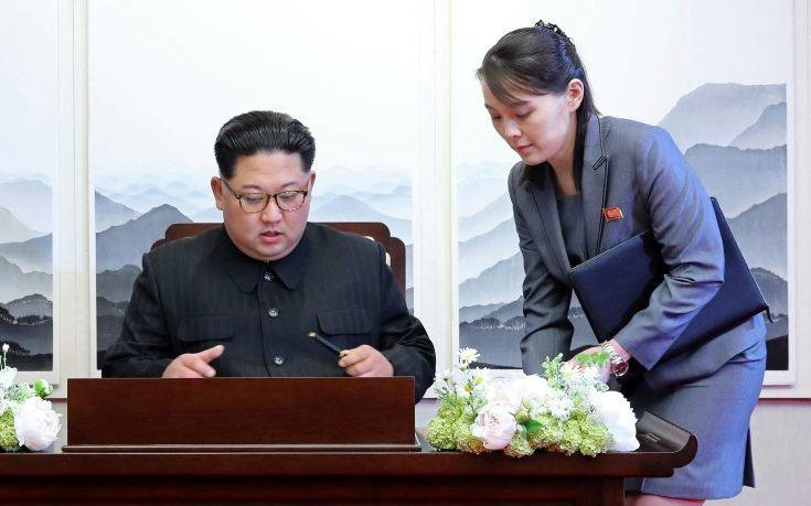 FILE - In this Friday, April 27, 2018, file photo, North Korean leader Kim Jong Un signs a guestbook next to his sister Kim Yo Jong, right, inside the Peace House at the border village of Panmunjom in Demilitarized Zone. Kim's younger sister handed her brother a pen when he signed the guestbook. Her proximity to her brother during most of the summit events Friday added credence to speculation that she's virtually the No.2 in the North. (Korea Summit Press Pool via AP, File)