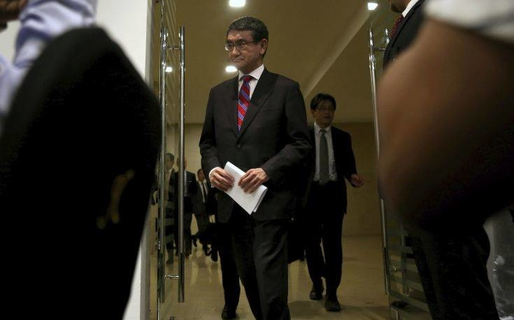 """Japan's Foreign Minister Taro Kono arrives at a news conference after a meeting on the """"Corridor for Peace and Prosperity,"""" at Dead Sea, Jordan, Sunday, April 29, 2018. (AP Photo/Raad Adayleh)"""