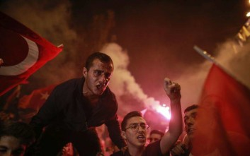 In this photo taken late Sunday, June 24, 2018, supporters of Turkey's President and ruling Justice and Development Party, or AKP, leader Recep Tayyip Erdogan, chants slogans during celebrations outside the party headquarters in Istanbul. Erdogan, 64 who has dominated Turkish politics for the past 15 years, is the winner of Sunday's polls and was set to extend his rule with sweeping new powers after winning landmark presidential and parliamentary elections. (AP Photo/Emrah Gurel)