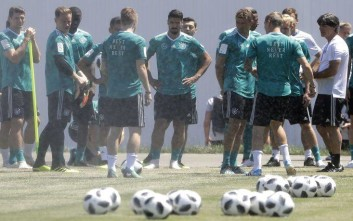 Germany head coach Joachim Loew, right, talks with his players during a training session in Sochi, Russia, Wednesday, June 20, 2018. Germany will face Sweden on June 23 in the group F for the soccer World Cup. (AP Photo/Andre Penner)