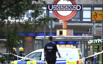 Emergency services attend the scene of a small explosion at Southgate Underground station, in London, Tuesday June 19, 2018. London police are investigating a small explosion at the Southgate Underground station that officials say does not seem to be related to terrorism. (Victoria Jones/PA via AP)