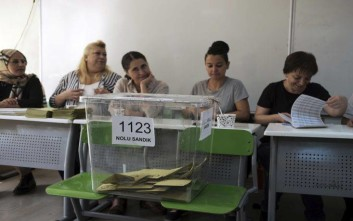 Officials representing political parties at a polling station at a primary school in Ankara, Turkey, Sunday, June 24, 2018. Turkey held high-stakes presidential and parliamentary elections on Sunday that could consolidate President Recep Tayyip Erdogan's hold on power or curtail his vast political ambitions. (AP Photo/Burhan Ozbilici)