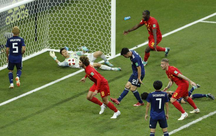 Belgium's Marouane Fellaini, center, celebrates after scoring his second side goal during the round of 16 match between Belgium and Japan at the 2018 soccer World Cup in the Rostov Arena, in Rostov-on-Don, Russia, Monday, July 2, 2018. (AP Photo/Hassan Ammar)