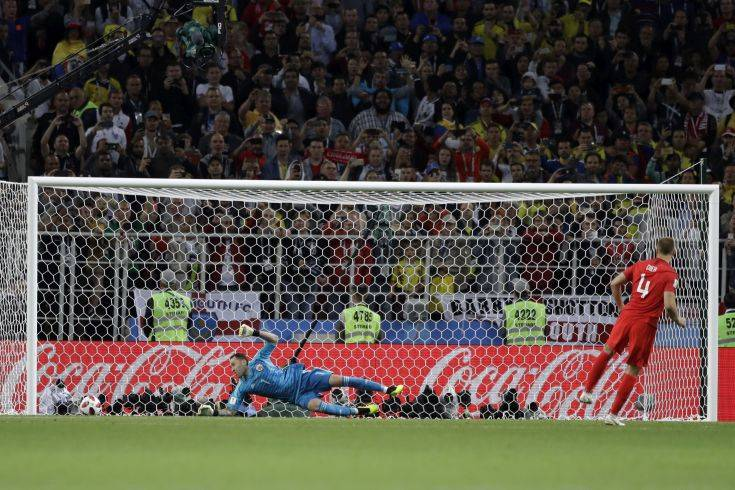 England's Eric Dier scores the wining penalty during the round of 16 match between Colombia and England at the 2018 soccer World Cup in the Spartak Stadium, in Moscow, Russia, Tuesday, July 3, 2018. England eliminates Colombia 4-3 on penalties after the game ends 1-1. (AP Photo/Matthias Schrader)