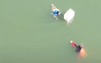 Η στιγμή που άντρας πηδάει από γέφυρα 21 μέτρων για να σώσει γυναίκα