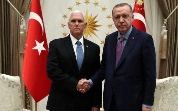 Παγωμένα βλέμματα και θερμοκρασία υπό του μηδενός στη συνάντηση Ερντογάν-Πενς
