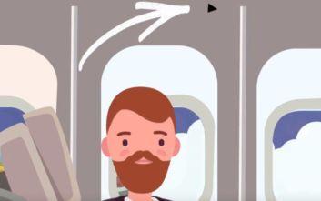 Τι σημαίνει το μικροσκοπικό τρίγωνο πάνω από τις θέσεις στο αεροπλάνο
