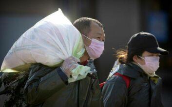 Κορονοϊός: Χαλαρώνουν οι περιορισμοί, αποκαθίσταται η παραγωγή στα εργοστάσια της Κίνας