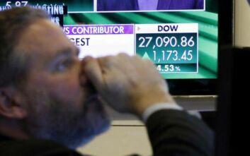 Ο κορονοϊός ταράζει τις διεθνείς αγορές - Βουτιά στις μετοχές