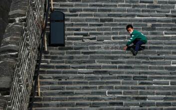 Κορονοϊός Κίνα: Ο αποκλεισμός ήρθη, αλλά η έξοδος των πολιτών εμποδίζεται λόγω του κανόνα να υποβληθούν σε νέο τεστ