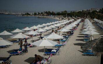 Διεθνής Τύπος: «Η Ελλάδα επιστρέφει στις παραλίες κρατώντας τις αποστάσεις ασφαλείας»